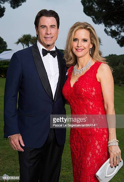 John Travolta and Kelly Preston pose for a portrait at amfAR's 21st Cinema Against AIDS Gala Presented By WORLDVIEW BOLD FILMS And BVLGARI at Hotel...