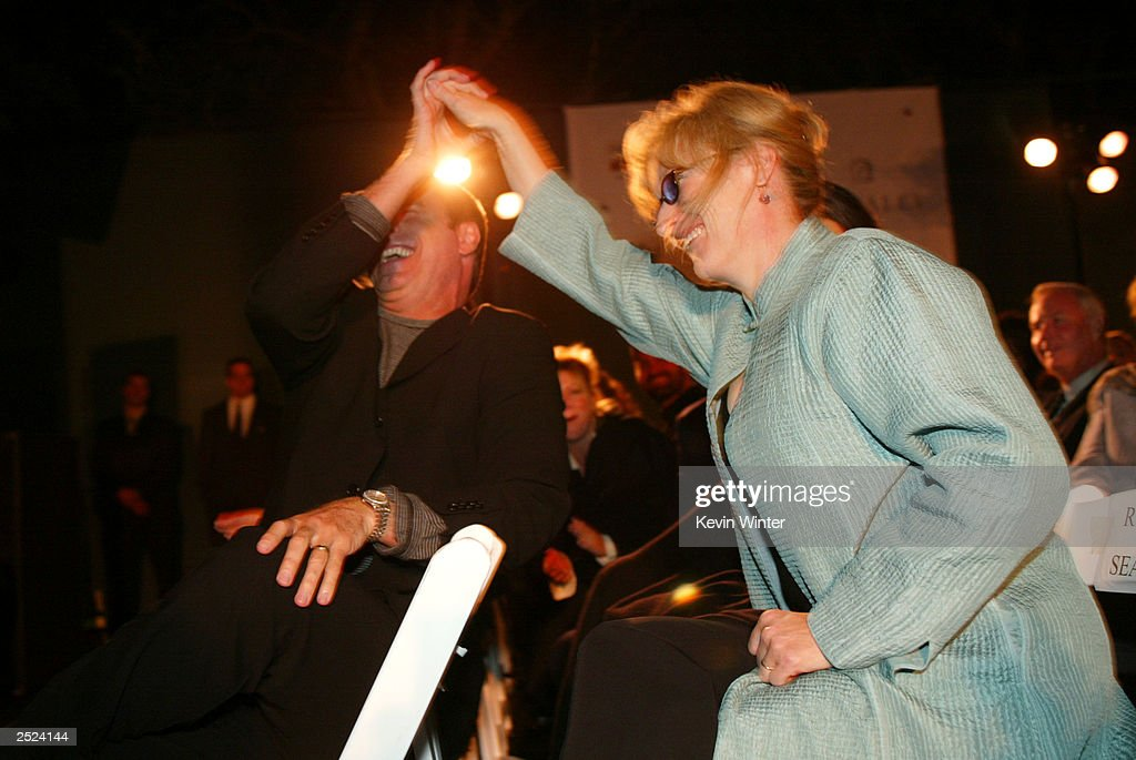 John Travolta and Meryl Streep at 'One World, One Child Benefit Concert' for the Children's Health Environmental Coalition (CHEC) honoring Meryl Streep, Nell Newman and Dr. Lawrie Mott at the home of Cindra and Alan Ladd in Beverly Hills, Ca. Thursday, Oct. 10, 2002. Photo by Kevin Winter/Getty Images.
