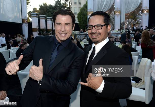 John Travolta and Michael Pena attend the Church of Scientology Celebrity Centre 44th Anniversary Gala on August 24 2013 in Los Angeles California