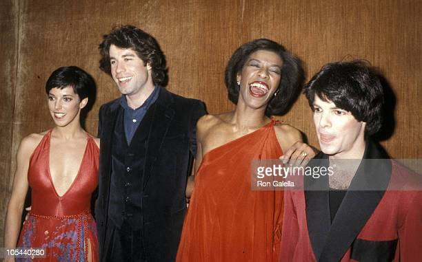 """John Travolta and Natalie Cole during """"Because We Care"""" Benefit for Cambodia at Dorothy Chandler Pavilion in Los Angeles, California, United States."""
