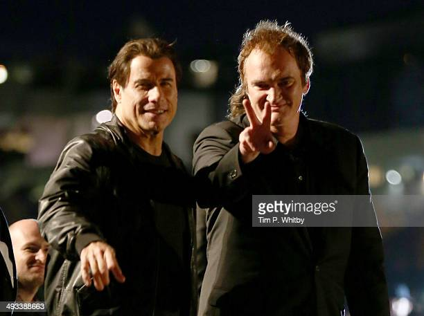 John Travolta and Quentin Tarantino attend a screening of Pulp Fiction at the 67th Annual Cannes Film Festival on May 23 2014 in Cannes France