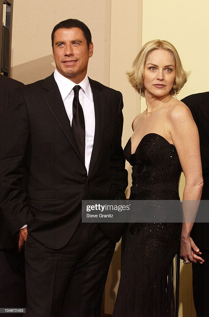 John Travolta and Sharon Stone during The 74th Annual Academy Awards - Press Room at Kodak Theater in Hollywood, California, United States.