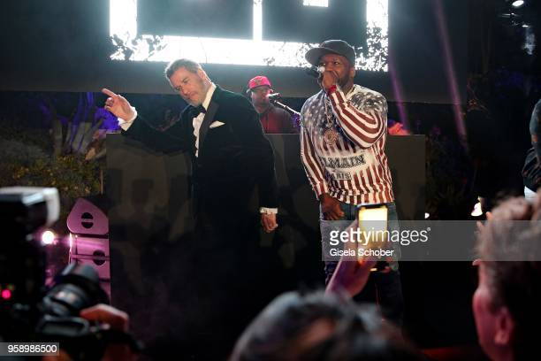 John Travolta and Singer 50 Cent on stage during the party in Honour of John Travolta's receipt of the Inaugural Variety Cinema Icon Award during the...