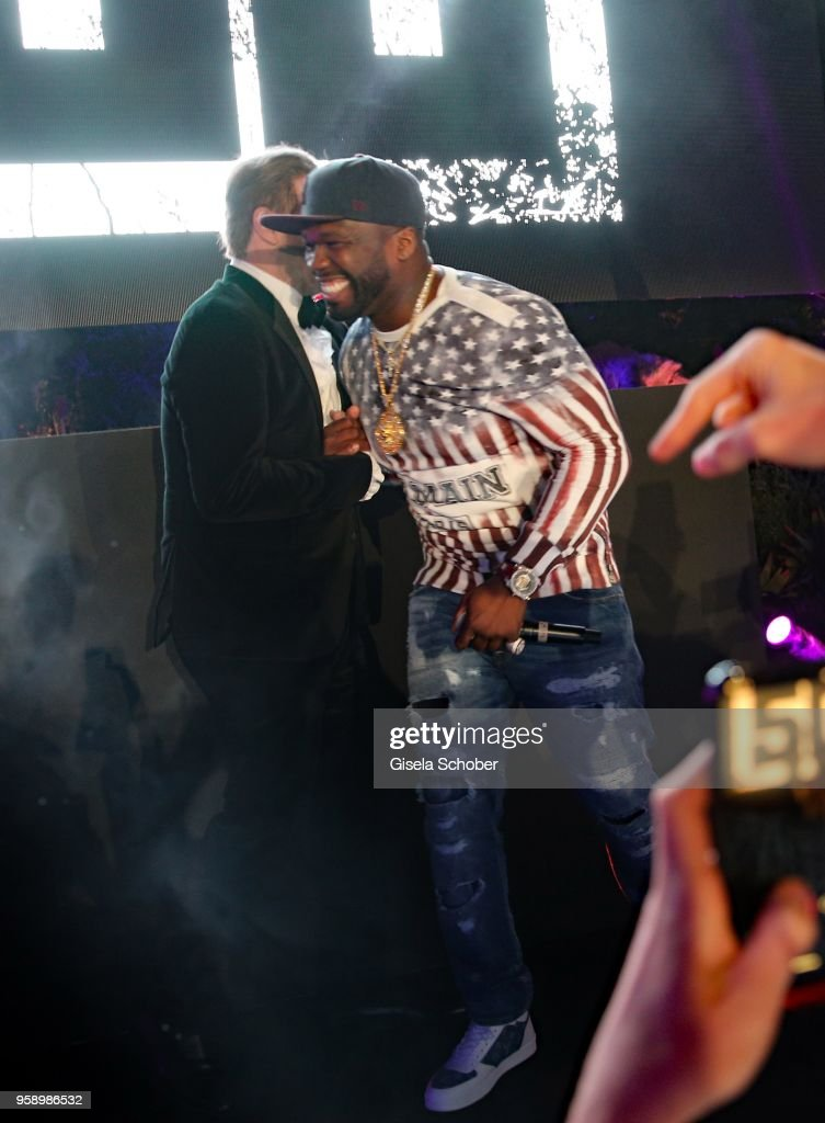 John Travolta and Singer 50 Cent ( Curtis James Jackson III ) on stage during the party in Honour of John Travolta's receipt of the Inaugural Variety Cinema Icon Award during the 71st annual Cannes Film Festival at Hotel du Cap-Eden-Roc on May 15, 2018 in Cap d'Antibes, France.
