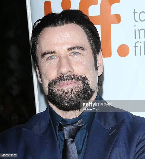 John Travolta arrives at the premiere of The Forger held during the 2014 Toronto International Film Festival Day 9 on September 12 2014 in Toronto...