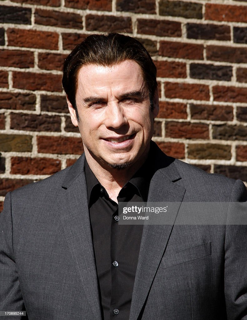 John Travolta arrives for the 'Late Show with David Letterman' at Ed Sullivan Theater on June 19, 2013 in New York City.
