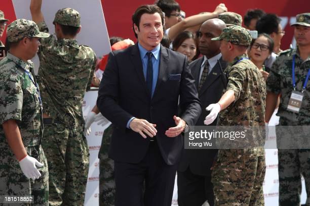 John Travolta attends a launching ceremony for the Qingdao Oriental Movie Metropolis on September 22 2013 in Qingdao China