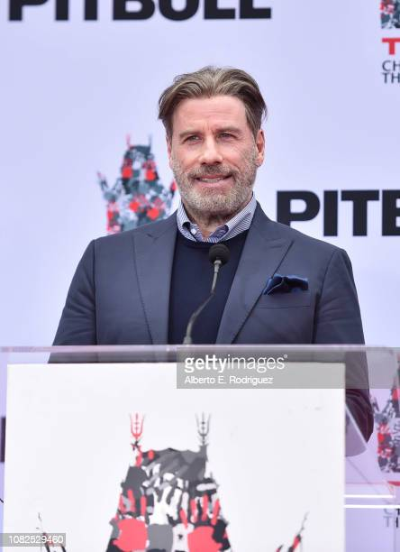 John Travolta attends the Hand And Footprint Ceremony Honoring Pitbull at TCL Chinese Theatre on December 14 2018 in Hollywood California