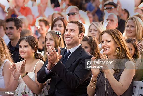 John Travolta , daughter Ella Bleu and wife Kelly Preston applaud speakers at the opening of a Scientology Mission on May 29, 2011 in Ocala, Florida.