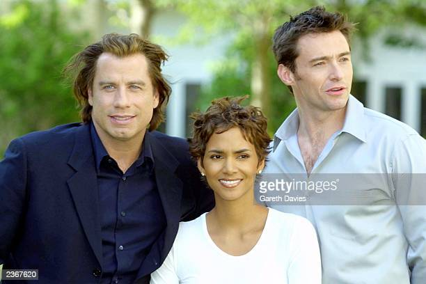 John Travolta Halle Berry and Hugh Jackman sit for a photo to promote their new movie Swordfish at the Four Seasons Hotel Canary wharf London 25/6/01...