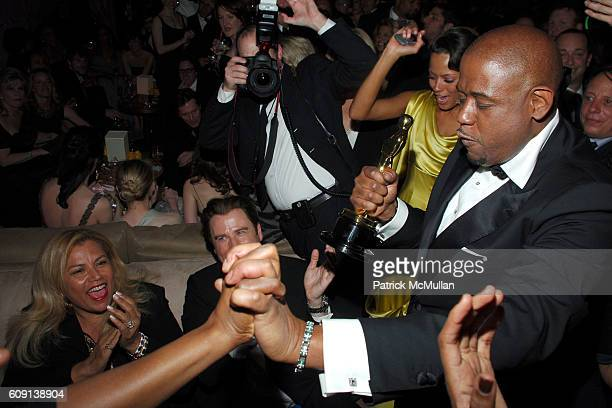John Travolta Keisha Whitaker and Forest Whitaker attend VANITY FAIR Oscar Party at Morton's on February 25 2007 in Los Angeles CA