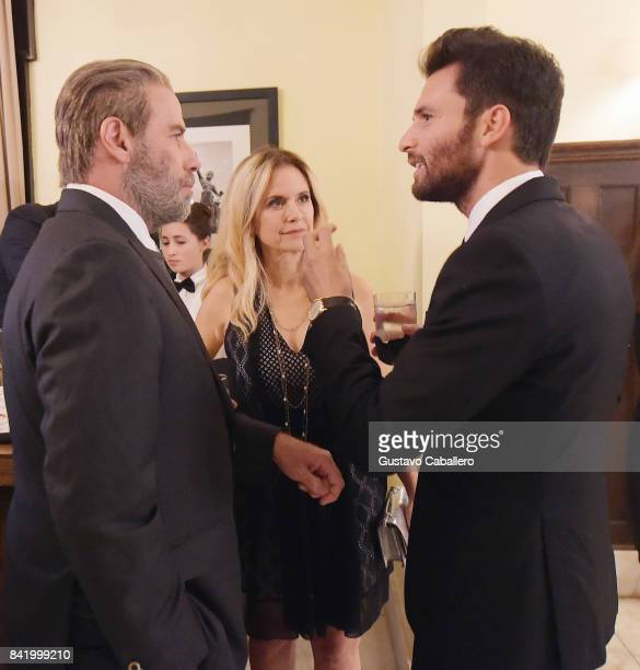 John Travolta Kelly Preston and Andrea Iervolino attend the Ambi Gala In Honor of the Movie 'Trading Paint' on September 1 2017 at an unspecified...