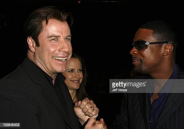 John Travolta Kelly Preston and Chris Tucker during Giorgio Armani Prive in LA Front Row at Green Acres in Los Angeles California United States