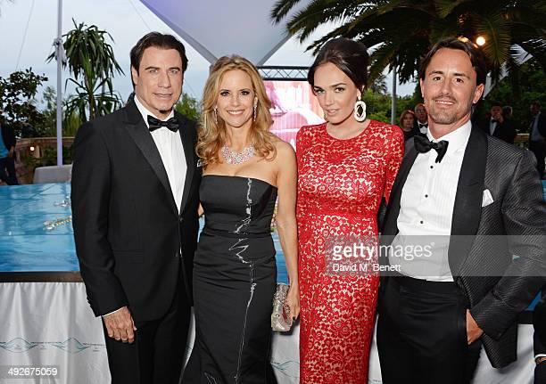 John Travolta, Kelly Preston, Tamara Ecclestone and Jay Rutland attend the welcome party for Puerto Azul Experience Night at Villa St George on May...