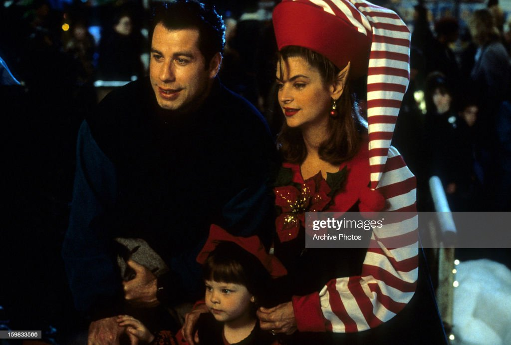 John Travolta, Kirstie Alley and two kids with the Christmas spirit ...