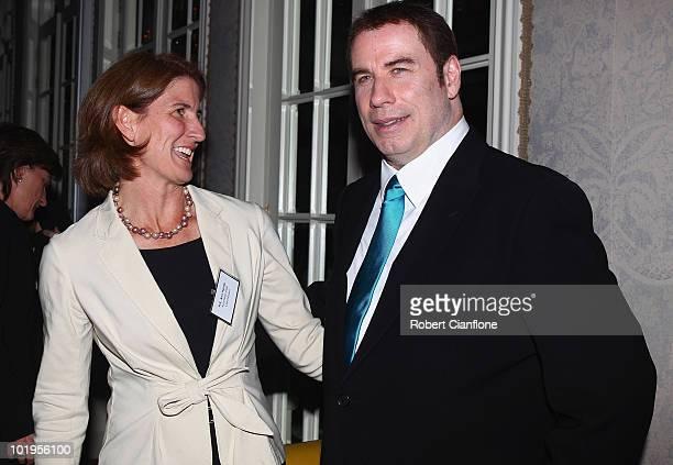 John Travolta Qantas Goodwill Ambassador greets Ann Harrap Australian High Commissioner to South Africa at an official Qantas function as he lends...