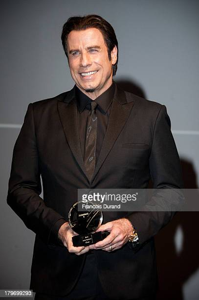 "John Travolta receives a tribute before the screening of ""Killing season"" during the 39th Deauville American Film Festival on September 6, 2013 in..."