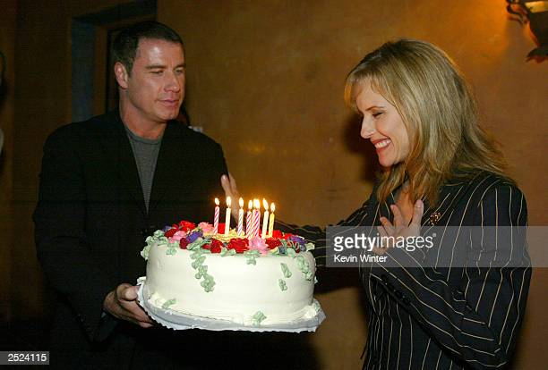 "John Travolta surprises wife Kelly Preston with a birthday cake at ""One World, One Child Benefit Concert"" for the Children's Health Environmental..."