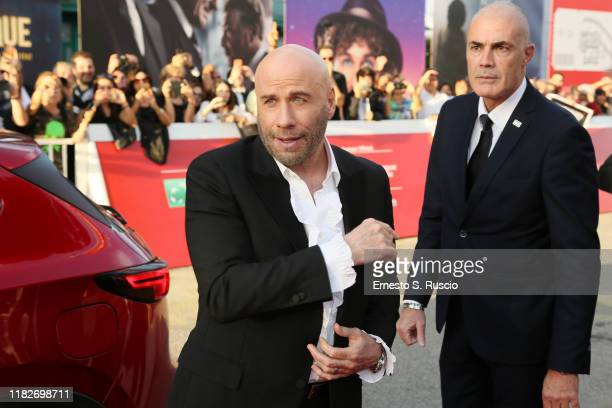 John Travolta takes selfies with fans on the red carpet during the 14th Rome Film Festival on October 22, 2019 in Rome, Italy.