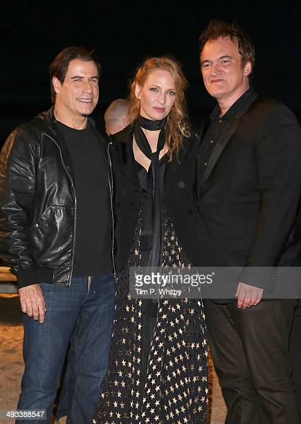 John Travolta Uma Thurman and Quentin Tarantino attend a screening of Pulp Fiction at the 67th Annual Cannes Film Festival on May 23 2014 in Cannes...
