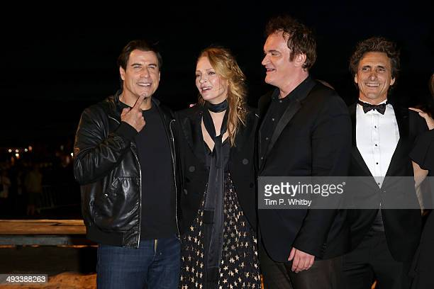 John Travolta Uma Thurman Quentin Tarantino and Lawrence Bender attend a screening of Pulp Fiction at the 67th Annual Cannes Film Festival on May 23...