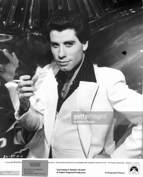 John Travolta with cigarette in a scene from the film 'Saturday Night Fever' 1977