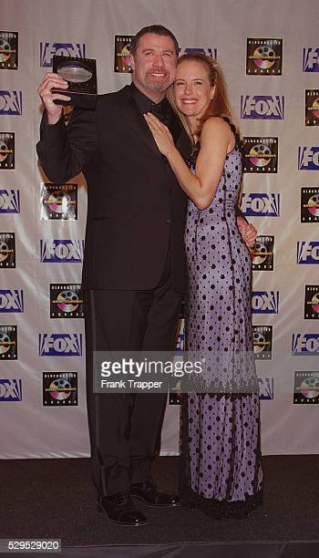 John Travolta with his wife Kelly Preston He won the award for best actor