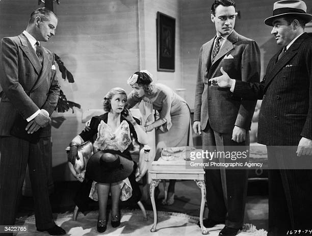 John Trent Genevieve Tobin Reginald Denny Marian Marsh and Edward Brophy appear in a scene from the Paramount film 'The Great Gambini' directed by...