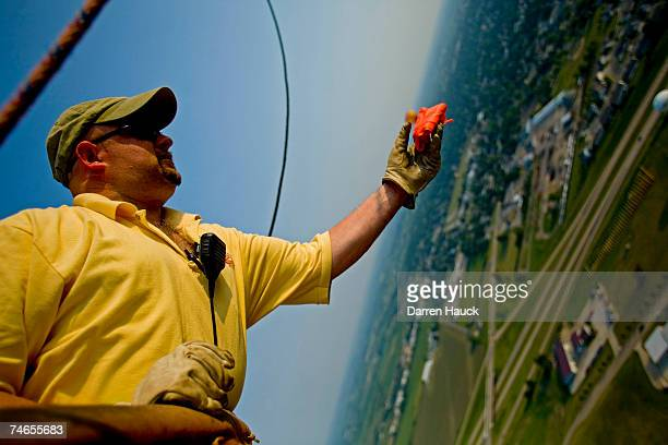 John Trione pilot of ''Easy Wind'' out of Lake Geneva Wis Gets ready to drop his bean bag as he participates in a game of ''Hare and Hound'' where...