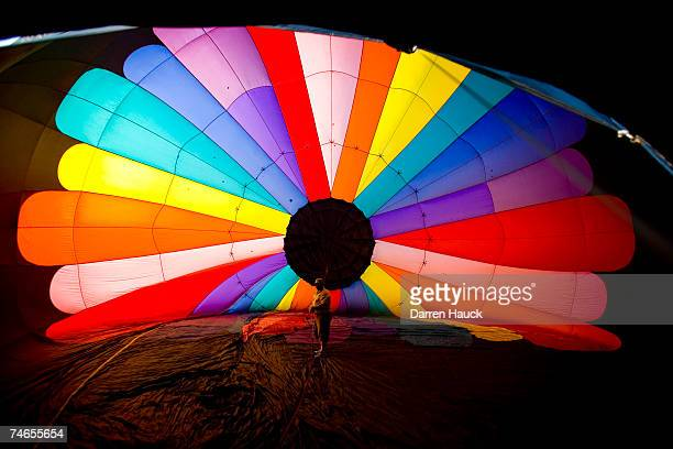John Trione stands inside his balloon ''Easy Wind'' out of Lake Geneva Wi before the start of the second evening flights of the 22nd annual Hot Air...