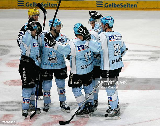 John Trip of the Freezers celebrates the second goal with his teammates during the DEL game between Koelner Haie and Hamburg Freezers at the...