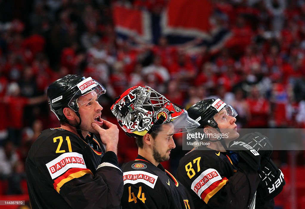 John Tripp, Dennis Endras and Philip Gogulla of Germany looks dejected after the IIHF World Championship group S match between Germany and Norway at Ericsson Globe on May 13, 2012 in Stockholm, Sweden.