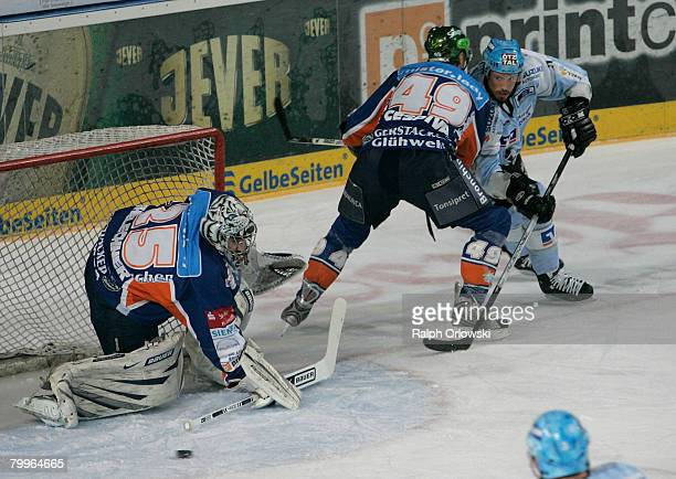 John Tripp of Hamburg tackles David Cespiva of Nuremberg during the DEL match between Sinupret Ice Tigers and Hamburg Freezers at the Arena...