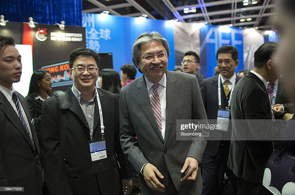 John Tsang Chun-Wah, Hong Kong's financial secretary, center, attends a cocktail party concluding the first day at the Asian Financial Forum in Hong Kong, China, on Monday, Jan. 14, 2013. The Asian Financial Forum runs until Jan. 15. Photographer: Jerome Favre/Bloomberg via Getty Images