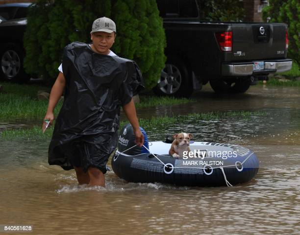 John Tuan returns to rescue his dog who was left in his flooded house in the Clodine district after Hurricane Harvey caused heavy flooding in Houston...