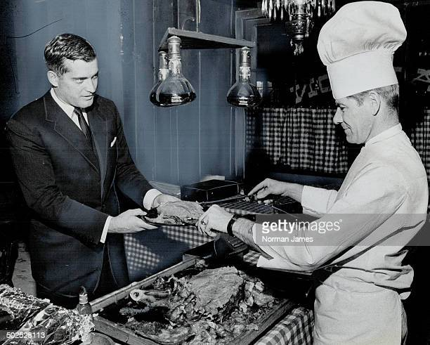 John Turner Canada's minister of consumer and corporate affairs enjoys sampling local specialties when he is travelling In this restaurant buffet it...