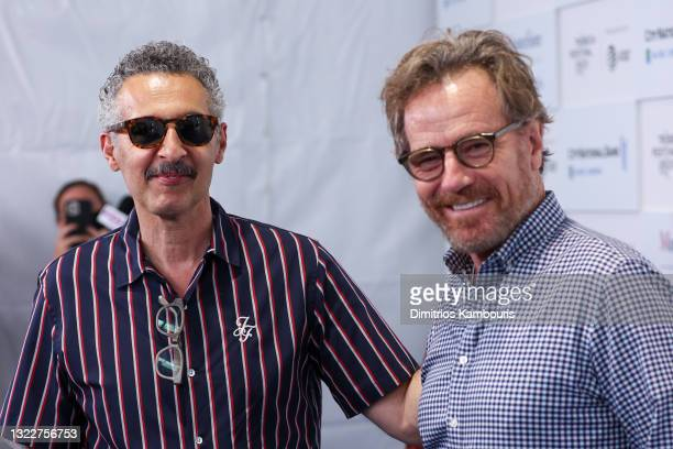 """John Turturro and Bryan Cranston attend the """"In The Heights"""" Opening Night Premiere during the 2021 Tribeca Festival at The Battery on June 09, 2021..."""