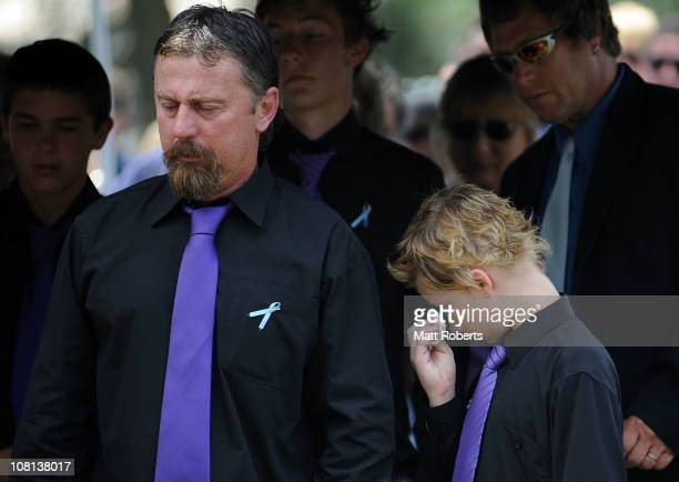 John Tyson stands next to his son Blake Tyson as they mourn at the funeral of family members Donna Maree Rice and son Jordan Rice killed in last...