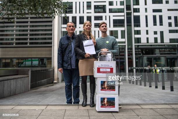 John Tyson the founder of a petition to bring in fire safety regulations to make Britain's tower blocks safer poses for a photograph with Sian Berry...