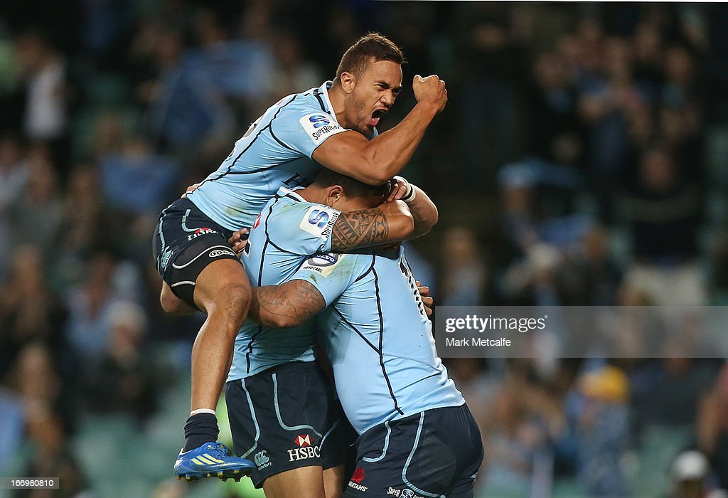 John Ulugia of the Waratahs celebrates scoring a try with teammates Israel Folau and Peter Betham during the round 10 Super Rugby match between the Waratahs and the Chiefs at Allianz Stadium on April 19, 2013 in Sydney, Australia.