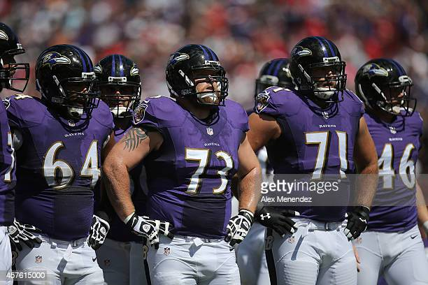 John Urschel Marshal Yanda Ricky Wagner and Morgan Cox of the Baltimore Ravens line up during an NFL football game at Raymond James Stadium on...