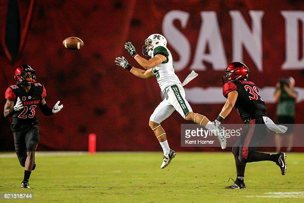 John Ursua of the Hawaii Rainbows cannot control possesion in the second half as Damontae Kazee of the San Diego State Aztecs prepares to intercept...