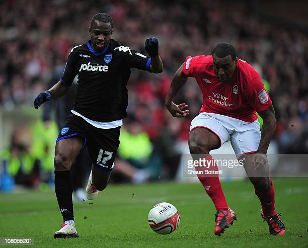 John Utaka of Portsmouth and Wes Morgan of Nottingham Forest challenge for the ball during the npower Championship match between Nottingham Forest...