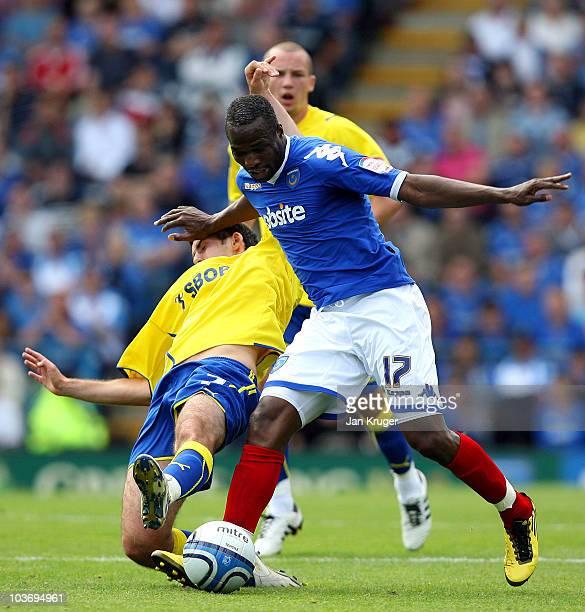 John Utaka of Portsmouth holds off Peter Whittingham of Cardiff City during the npower Championship match between Portsmouth and Cardiff City at...
