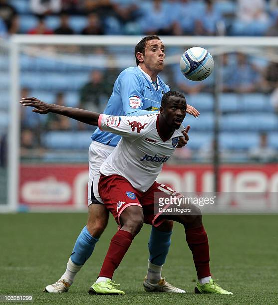John Utaka of Portsmouth is challenged by Richard Keogh during the npower Championship match between Coventry City and Portsmouth at the Ricoh Arena...