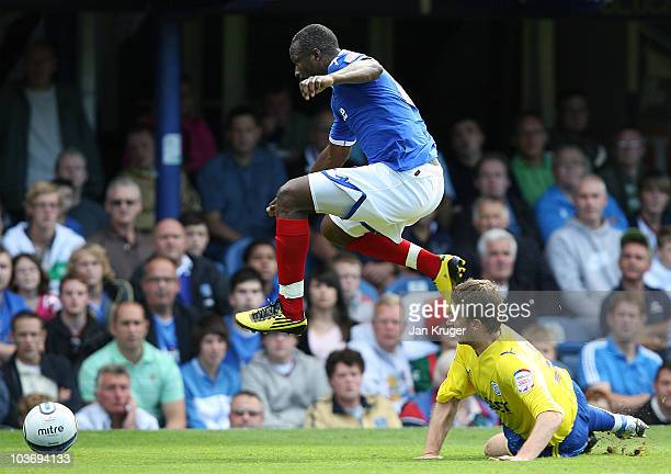 John Utaka of Portsmouth leaps over the tackle of Lee Naylor of Cardiff City during the npower Championship match between Portsmouth and Cardiff City...