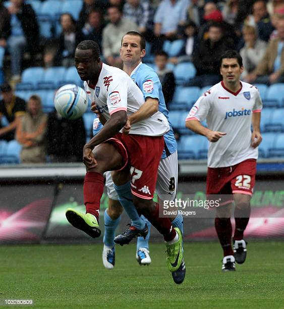 John Utaka of Portsmouth passes the ball as Michael Doyle challenges during the npower Championship match between Coventry City and Portsmouth at the...