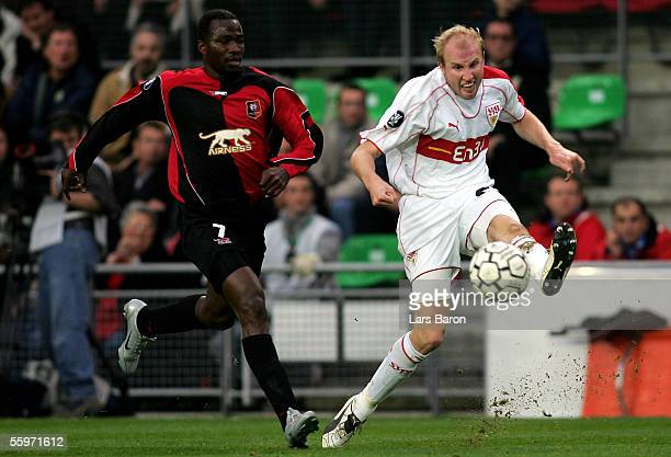 John Utaka of Rennes challenges Ludovic Magnin of Stuttgart for the ball during the UEFA Cup Group G match between Stade Rennais FC and VfB Stuttgart...