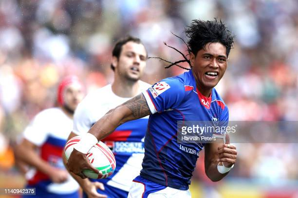 John Vaili of Samoa runs in to score a try against France on day three of the Cathay Pacific/HSBC Hong Kong Sevens at the Hong Kong Stadium on April...