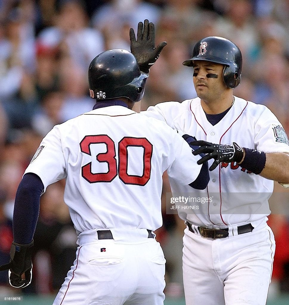 John Valentin (R) Of The Boston Red Sox Is Congratulated By Jose Offerman  After